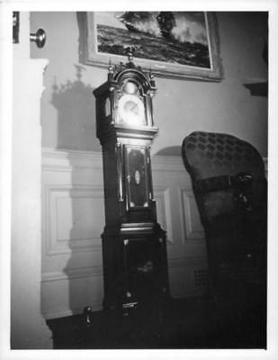A Longcase clock on the wall. - Vintage photo