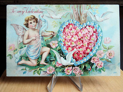 1908 Embossed Valentine Postcard Cupid Heart Of Flowers and White Doves