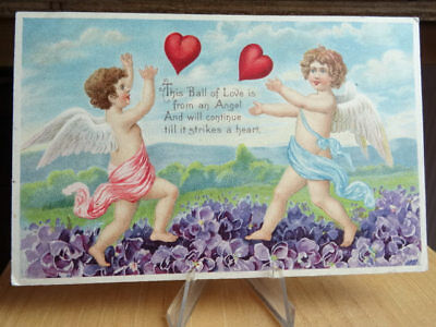 1908 Valentine Postcard Cupid Playing With Hearts In A Bed Of Flowers
