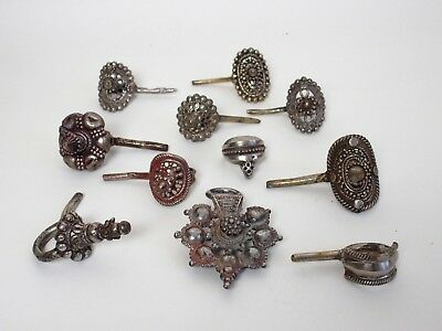 Eleven antique metal Indian / Tibetan - horse or camel fittings decorations