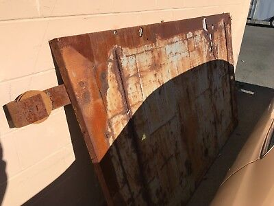 "Rolling fire door metal clad 100 years old aproxamitly 54""x78"" solid wood with r"