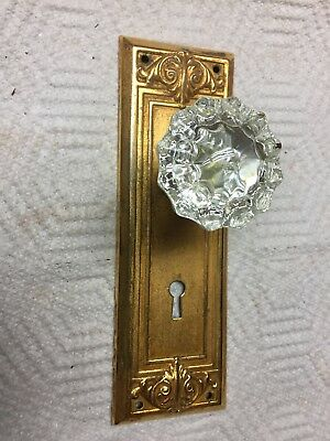 Antique Door Backplate With A Glass Knob Fastened To It For A Crafting Hook