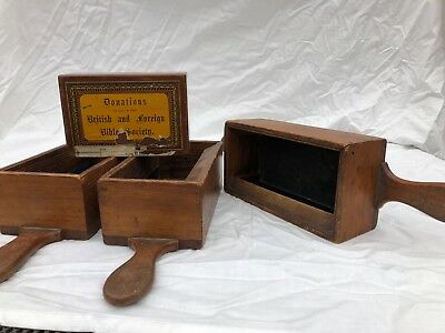 A collection of antique wooden church collection boxes all in good condition