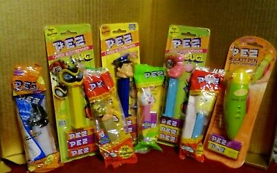 8 Vintage PEZ Dispensers, Action fugures, Police, Army, Bugs, holidays.