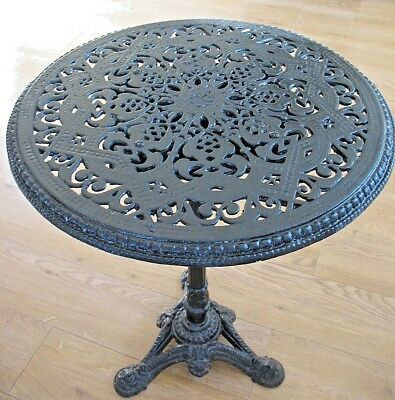 Old antique vintage all cast iron garden bistro or pub table wit fretwork top