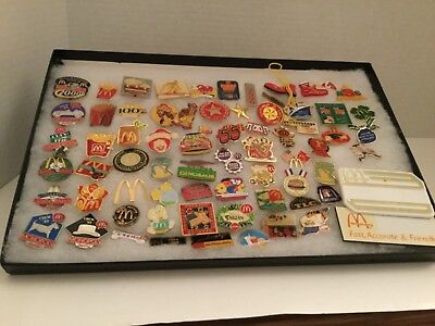 A neat collection of McDonald's crew pins, 70 pieces including two plastic name