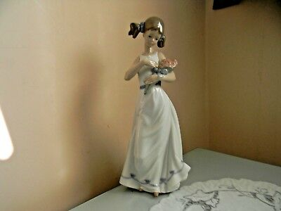 Nao By Lladro Spring Petals Girl With Flowers Figurine