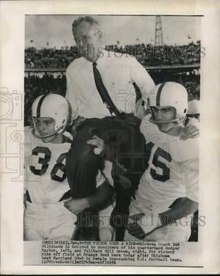1956 Press Photo Oklahoma's Bud Wilkinson gets victory ride after Orange Bowl.