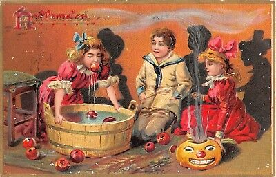 1908 Boy & 2 Girls Apple Bobbing Jack O'Lantern Halloween post card Tuck