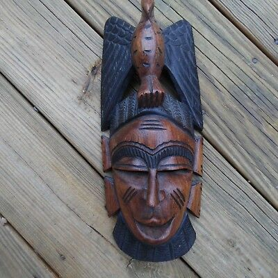 Hand carved African wooden mask ethnic wood carving Ghana Africa