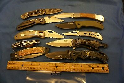 7829   Ten assorted pocket knives