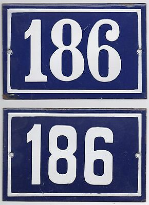 Old blue French house number 186 door gate wall fence street sign plate plaque