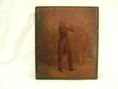 Vintage etched copper and wood printing block conductor and orchestra