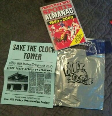 Back to the future prop sports almanac, clock tower sign, receipt,store bag