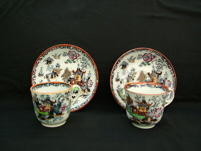 Antique willow pattern cups and saucers decorated in Imari colours