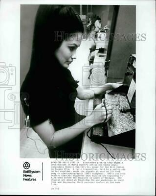 Press Photo Marty Gary Tests Small Electrical Components - KSB35431