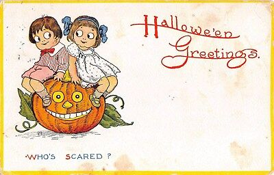 1913 Boy & Girl Siting on Jack O Lantern Halloween post card as is