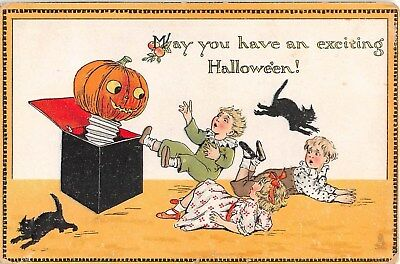 1913 Jack O Lantern Jack in Box Children & Black Cats Halloween post card Tuck