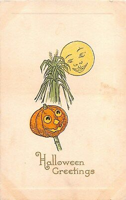 c.1913 Jack O Lantern Sheath of Wheat & Moon Face Halloween post card