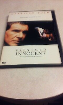 3 Used DVD movies Presumed innocent, minority report, and double jeopardy