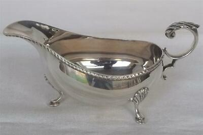 A Stunning Solid Sterling Silver Cream / Sauce Boat Birmingham 1982.