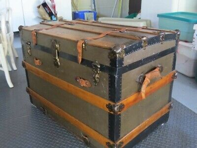 "Antique Travel trunk. Good condition. 23"" high, 21"" wide, 34"" long. One broken h"