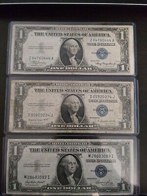 1935 A - G - E United States one dollar Silver Certificates (Three Total)