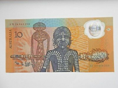 LOOK AT THIS ONE /    UN-CIRCULATED 1988 $10 FIRST POLYMER NOTE No creases,