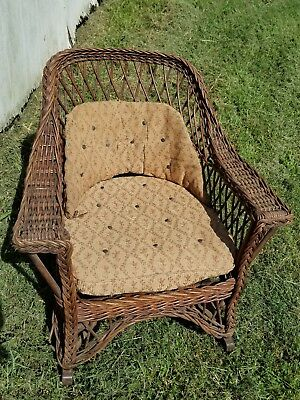 Antique Wicker Rocking Chair with Seat Springs.