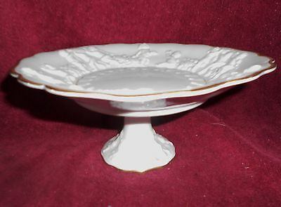 White Compote on Stem with Cupids on Edge-used--SALE