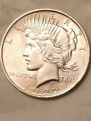 1922 Peace Silver Dollar. No mint mark. Coin is in very good condition.