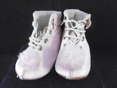 Vintage pair of French childrens booties. Pink leather with pompoms.