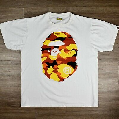1c582f53 BAPE 1st Camo Big Ape Head Tee Shirt White Orange 100% Authentic $250 on  StockX