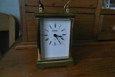 metal cased quartz carriage clock     richardsons    darlington