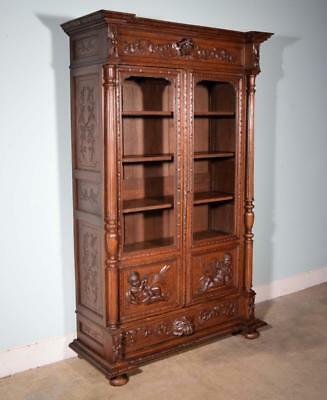 *Antique French Renaissance Revival Bookcase in Oak with Cherub Carvings