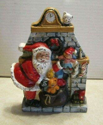 """8 1/2"""" Cast Iron Door Stop Santa Clause w Bag of Toys coming out Fireplace DD12"""