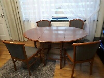 Vintage solid oak drop leaf table with gate, twisted leg and 4 chairs