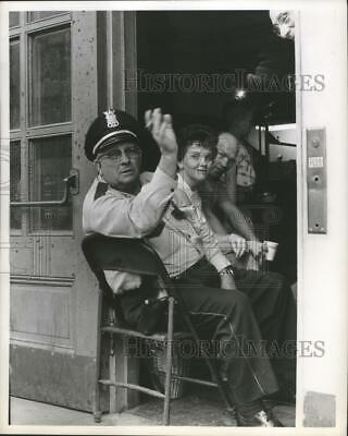 1963 Press Photo Officer sits at the door of City Auditorium, Houston