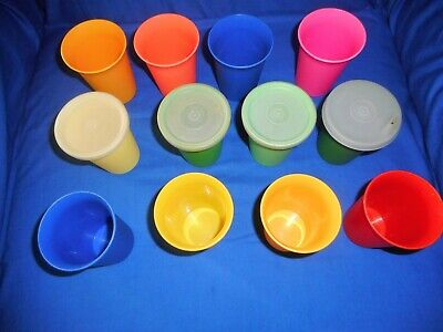 12   Vintage Tupperware small  tumblers, 8 oz, 3 lids 1 sippy lid bell shape