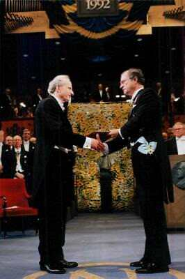 Gary Becker receives the Nobel Prize by King Carl XVI Gustaf in the Concert Hall