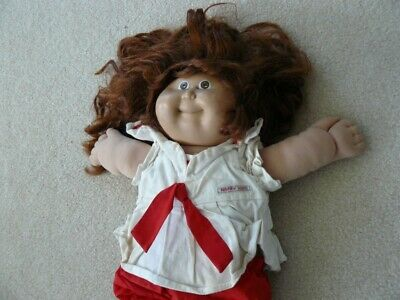 "This is a cabbage patch doll, in neglected condition.  16"" tall"