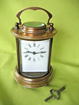 Old antique vintage brass circular carriage white enamel faced mantle clock