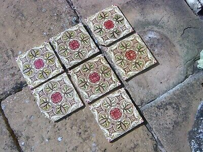 Seven decorative old ceramic tiles - 15.4 x 15.4 cm - two chipped - pink & green