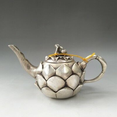 China's Tibetan silver carved lotus root frog statue lid teapot.
