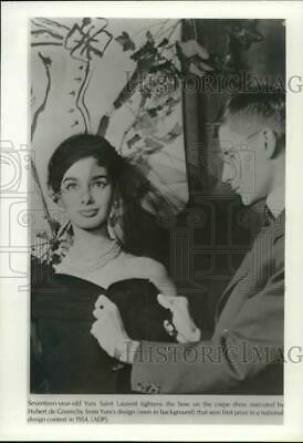 d8c1c7bd881 Press Photo Yves Saint Laurent with winning dress in national design contest