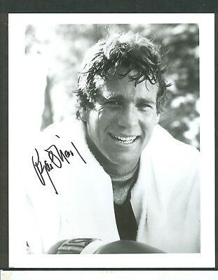"""Ryan O'neal Signed 8x10"""" Glossy Black & White Photo - Signed in black Sharpie"""