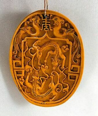 Unusual Vintage Chinese Hand Carved Yellow Pendant Medallion Fighting Dragons