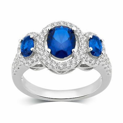 Divina Sterling Silver Created Blue and White Sapphire Three Stone Oval Frame