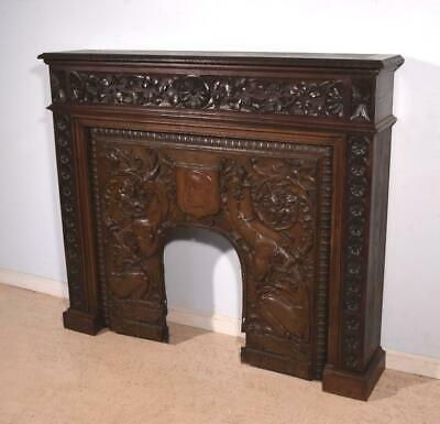 Antique French Gothic Revival Oak Fireplace Surround/Mantel with a Bronze Insert