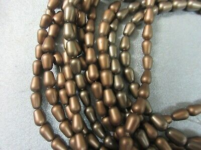 12 strands of bronze colored beads 6x9mm drop shape  50/strand New Old Stock C85